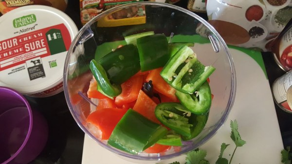 Getting the peppers ready to chop.