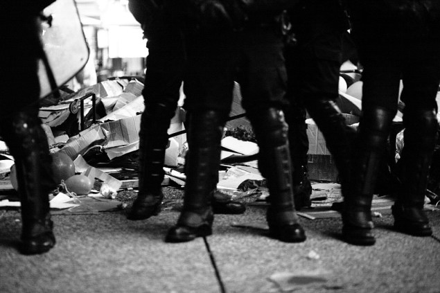 In Paris, police in riot gear attacked tents and then rigorously guarded the piles of trash they made. November 15, 2011. Photo by Sebastien Gabriel Meriadeck.