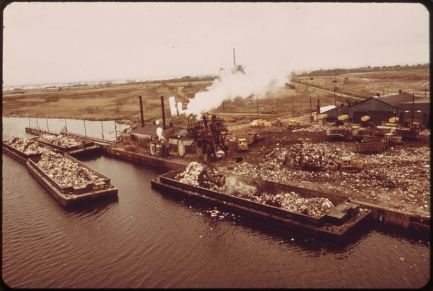 Barges transport waste to Fresh Kills in 1973.