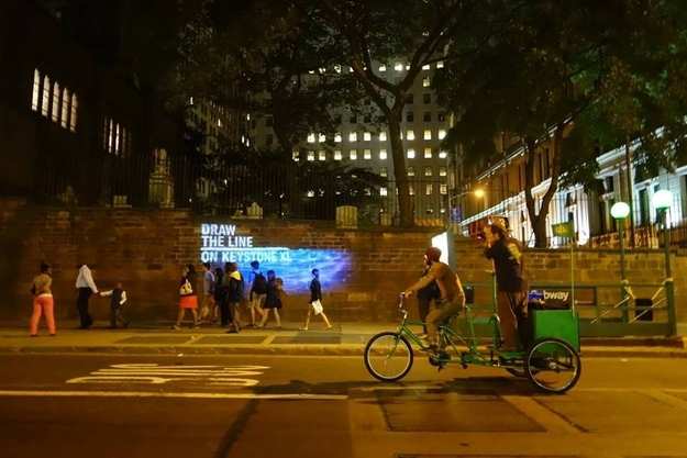 A high water line showing where Wall Street will be flooded due to climate change, projected by The Illuminator collective. Photo via Lucky Tran.