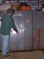 """Original caption: """"Wayne shows the water level in the shop relative to the volunteers' lockers. IRENE at the bottom was 20 inches. SANDY was 30 inches above the floor, and Wayne's left hand points to what was narrowly avoided -- the 1938 flood level. J.Hakner"""" From http://www.bera.org/sandy.html"""