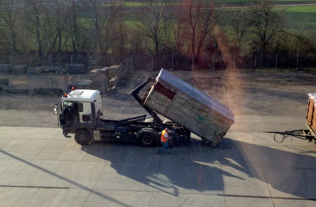 Recently arrived truck preparing to unload a container of shredded waste (sometimes also called Refuse Derived Fuel, or RDF). Author's photo.