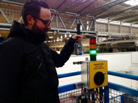 Sean Bonner of SafeCast uses the DIY Geiger counter to measure our radiation levels while dumpster diving at CERN.