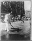 New York City sanitation dept. employee sweeping street, ca. 1910.