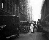 Street sweeper in traffic, early 20th century photo. Photo courtesy DSNY.