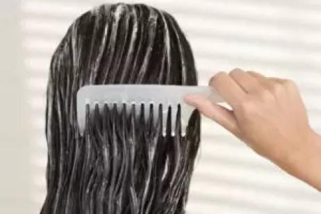 Woman combing her wet hair