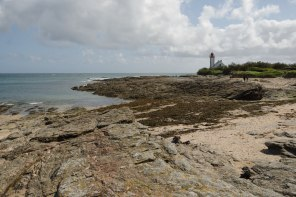The low mineral coast and the lighthouse at la Pointe des Chats, on the island of Groix