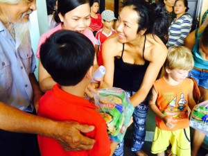 Giving food for kids in nha trang