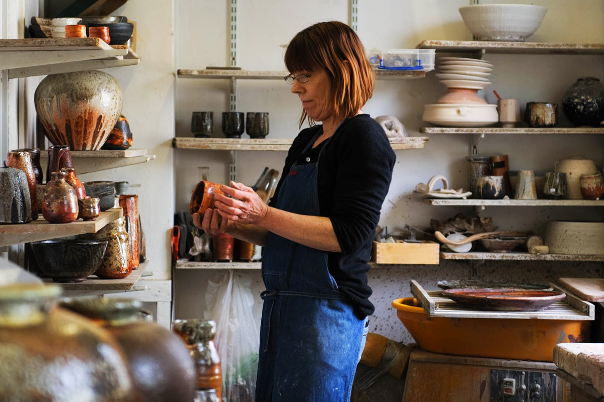 Lisa-Hammond-Studio-Tour-Inspecting-Pots
