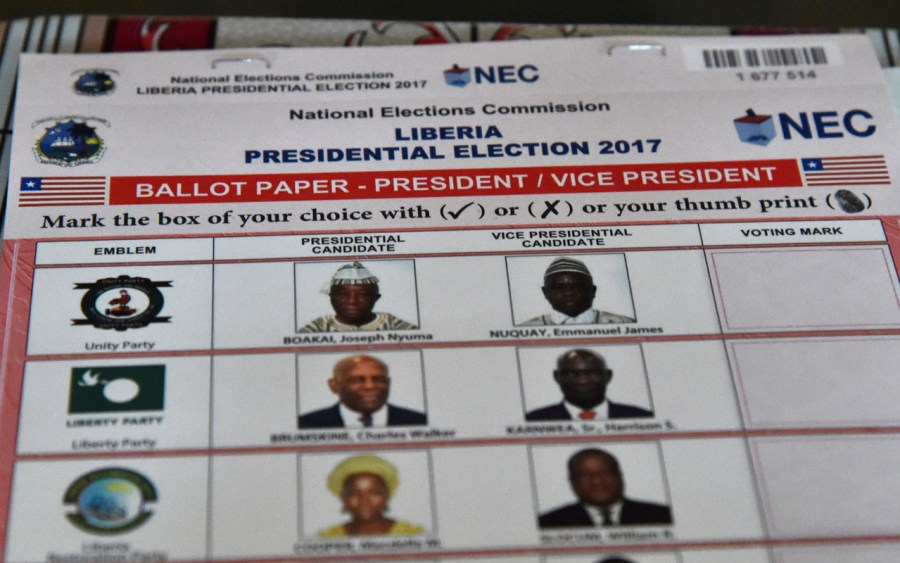 """(FILES) This file photo taken on October 10, 2017 shows a ballot paper at a polling station in Monrovia during presidential and legislative elections. """"REMEMBER TO VOTE"""" wrote Liberia's National Elections Commission (NEC) on its Facebook page on October 26, 2017, a daily reminder to Liberians that the final stage of selecting their president is fast approaching. / AFP PHOTO / ISSOUF SANOGO"""
