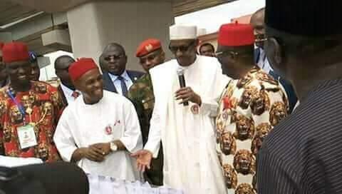 L-R Minister Onu, President Buhari and Gov. Umahi as President visits, Ebonyi