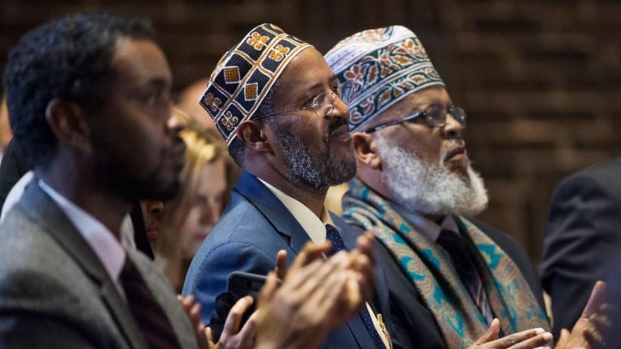 Minneapolis city council member Abdi Warsame, left, Imam Abdisalam Adam, center, from the Islamic Civic Society of America and Imam Saad Roble, President of the World Peace Organization, attend an event in Minneapolis, Minnesota, Dec. 15, 2015. Credit/voa
