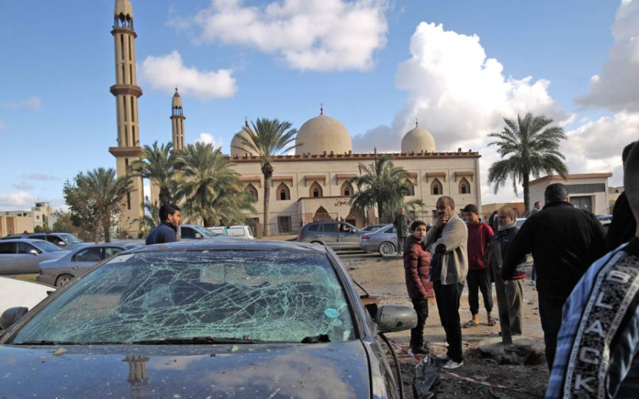 Libyans check the aftermath of an explosion in the eastern city of Benghazi on January 24, 2018. The death toll following a double car bomb attack in the Libyan city of Benghazi night has risen to at least 34, and at least 87 persons were reported to have been  injured, a hospital spokeswoman said / AFP PHOTO / Abdullah DOMA