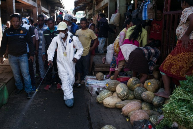 [Representative Image] People stand back as a council worker sprays disinfectant during the clean-up of the market of Anosibe in the Anosibe district, one of the most insalubrious districts of Antananarivo, MadagascarGetty Images