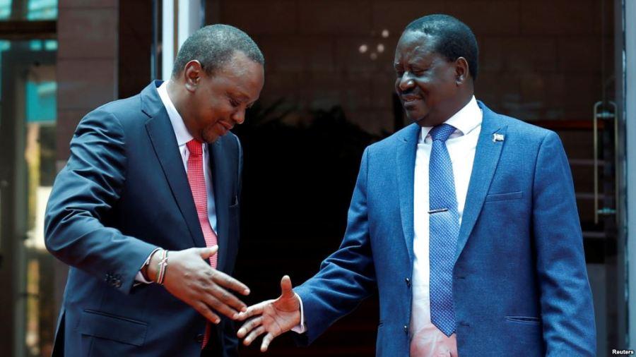 Kenya's President Uhuru Kenyatta, left, and opposition leader Raila Odinga of the National Super Alliance (NASA) coalition shake hands after a joint news conference in Nairobi, March 9, 2018. Credit/VoA