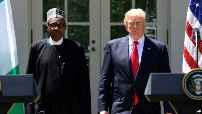 President Donald Trump and Nigerian President Muhammadu Buhari arrive for a news conference in the Rose Garden of the White House in Washington, April 30, 2018. Credit/VoA