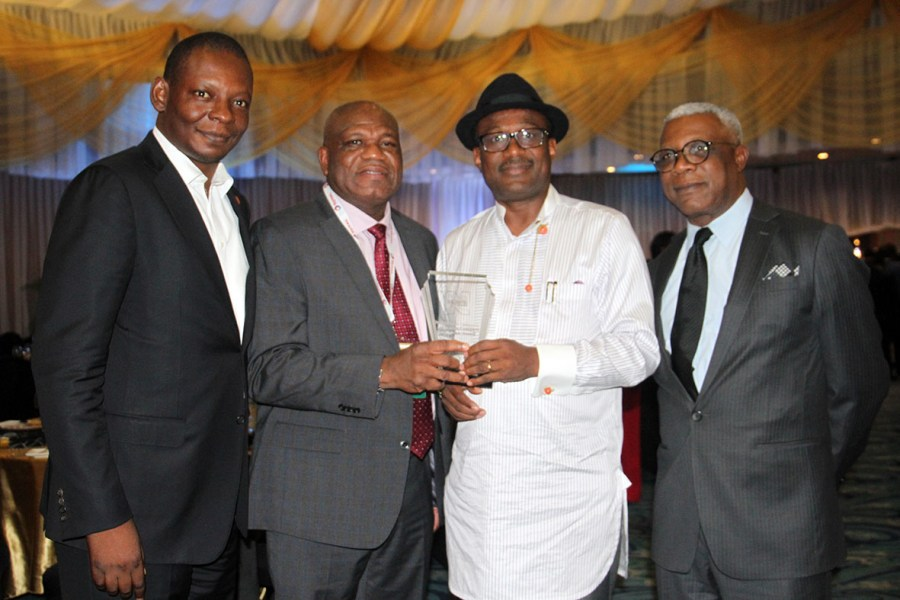 (L-R) Mr. Ewariezi Useh, Managing Director, Downstream, Aiteo Group; Mr. Emmanuel Ukegbu, Chief Operating Officer, Aiteo Eastern Exploration and Production Company; Engr Simbi Wabote, Executive Secretary, Nigerian Content Development and Monitoring Board and Dr. Ransome Owan, Group Managing Director, Aiteo Power, at the 2018 Nigeria Oil & Gas Conference where Aiteo Group emerged Indigenous Oil & Gas Company of the year, in Abuja