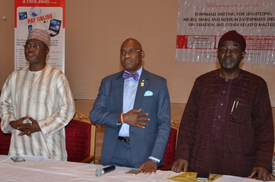 From L: Representative of the Chief Executive Officer of SMEDAN and Director, Policy, Advocacy and Coordination, Monday Ewans, Representative of the Executive Chairman of FIRS and Secretary of JTB, Oseni Elamah, FIRS State Coordinator, Kano, Jigawa and Katsina, Pam Davou at the MSMEs sensitisation in Kano on Wednesday, July 25, 2018