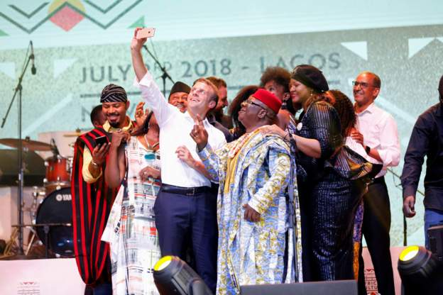 Macron takes selfie with fun lovers at the Shrine