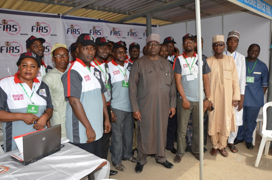 Stimulating the economy: The Executive Chairman of FIRS (middle) with FIRS participants at Katsina MSME clinic recently