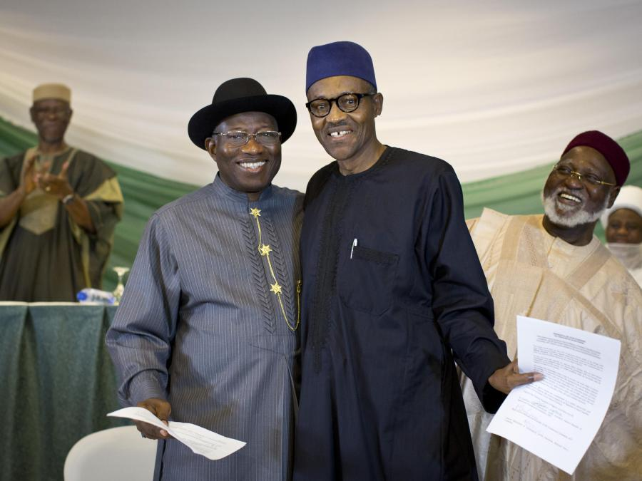 """Former Nigeria's President Goodluck Jonathan, and then  opposition candidate Gen. Muhammadu Buhari, , after signing a renewal of their pledge to hold peaceful """"free, fair, and credible"""" elections in 2015."""