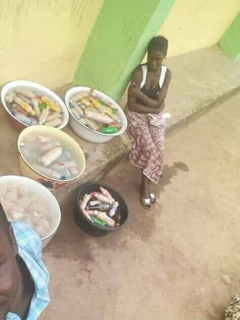 A woman with business sense prepares Kunu, a locally brewed drink to sell to voters at a close-by a polling booth. Without electricity and refrigerator, the drink will all spoil in one day.