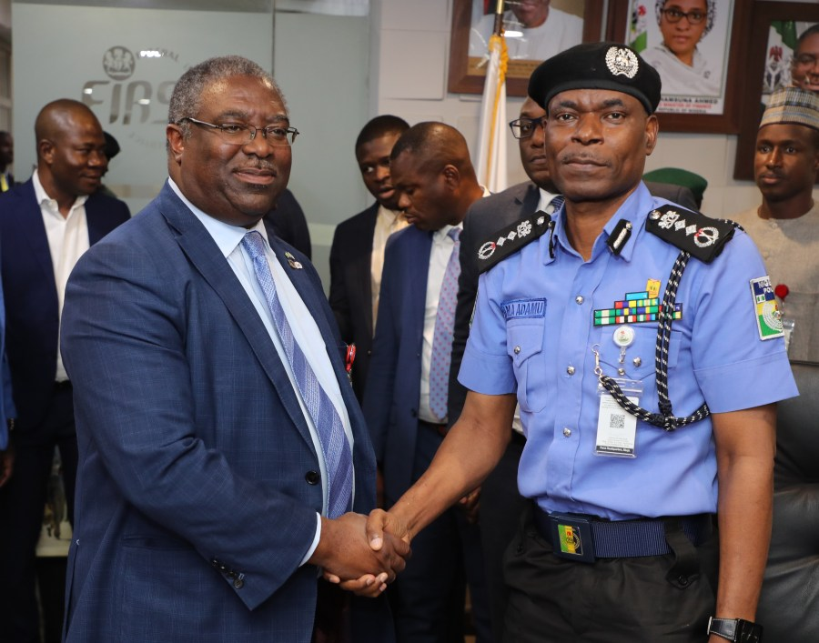 From L-R Executive Chairman Federal Inland Revenue Service. Tunde Fowler in a handshake with Inspector General of Police Muhammad Abubakar Adamu