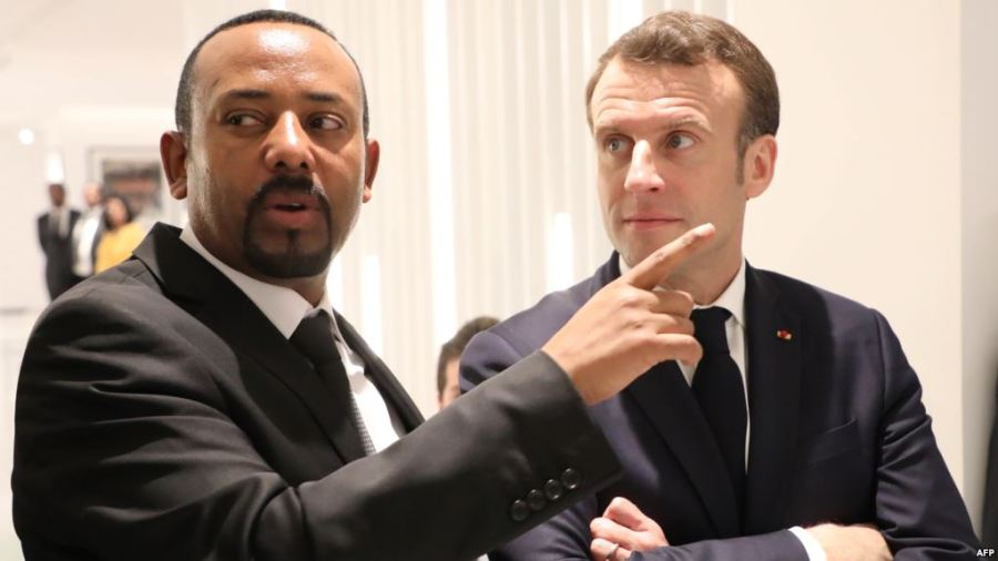 Ethiopian Prime Minister Abiy Ahmed (L) speaks with French President Emmanuel Macron (R) before a meeting in Addis Ababa, March 12, 2019. Credit/VoA