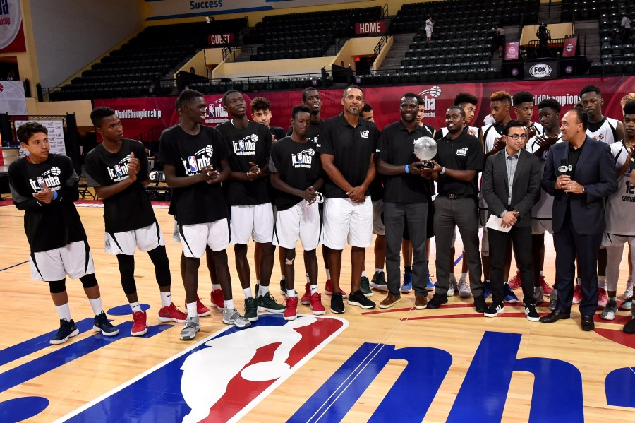 ORLANDO, FL - AUGUST 11: The Africa and Middle East Boys receive the 2018 Boys International Champion trophy during the Jr. NBA World Championship U.S. Finals on August 11, 2018 at ESPN Wide World of Sports Complex in Orlando, Florida. NOTE TO USER: User expressly acknowledges and agrees that, by downloading and or using this Photograph, user is consenting to the terms and conditions of the Getty Images License Agreement. Mandatory Copyright Notice: Copyright 2018 NBAE (Photo by David Dow/NBAE via Getty Images)