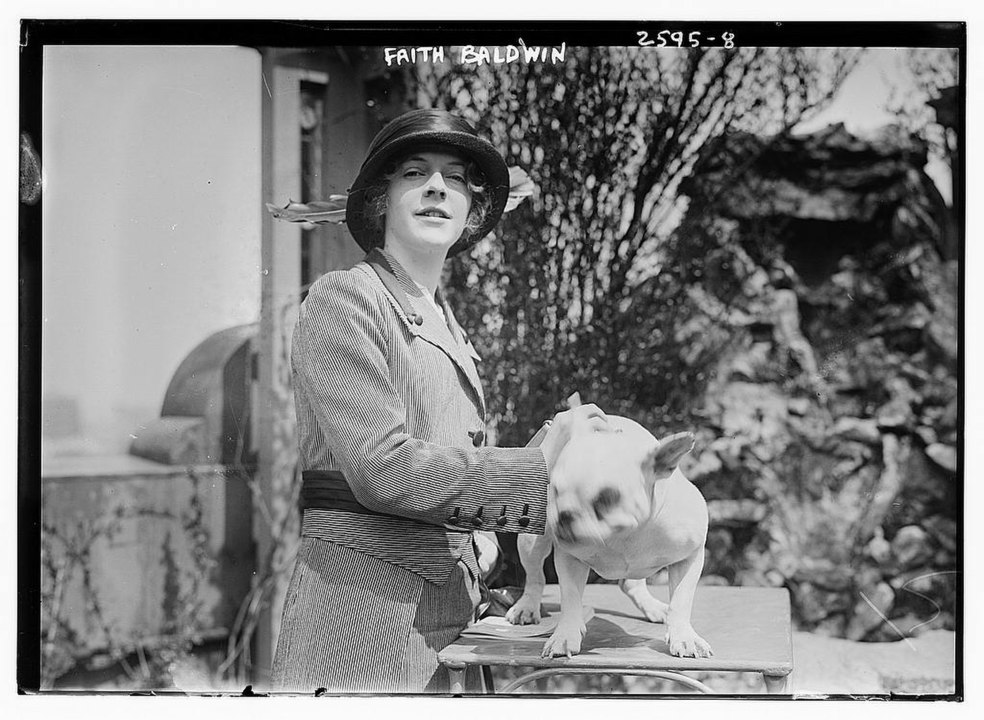 Image of Faith Baldwin in the 1920s with a dog