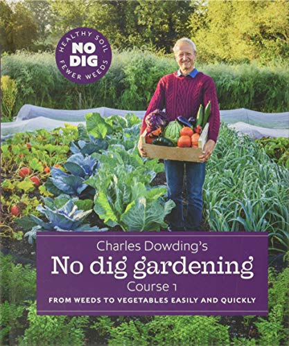 Image of Charles Dowding in his garden with a huge basket full of vegetables - This is the book cover.