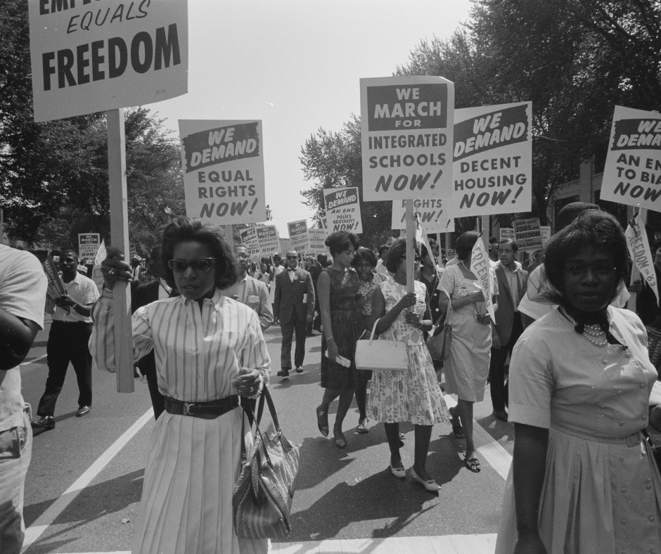 African- American protestors from the 1950s with signs demanding equal rights