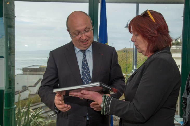 "The ambassador is presented with ""Historical Highlights of Douzelage"" by Denise Connolly. Pic CMP Productions — with Ambassade de France en Irlande at Discover Bundoran."