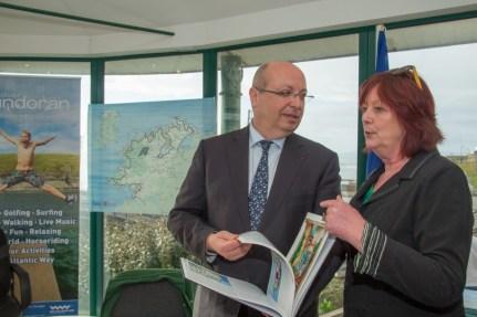 Denise tells the ambassador more about Douzelage. Pic CMP Productions — with Ambassade de France en Irlande at Discover Bundoran.