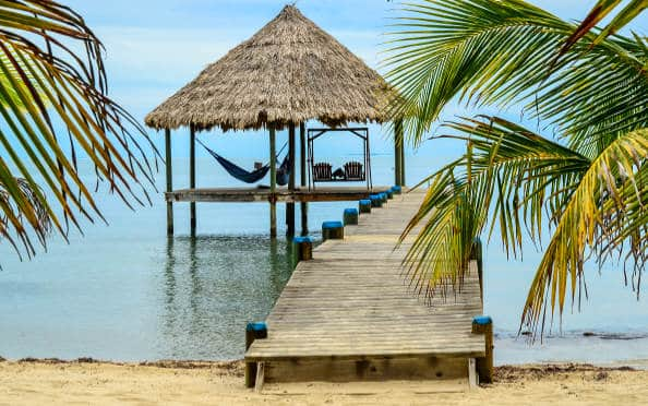 a palapa over the water in belize