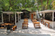 a jungle side open air restaurant considered one of the best in town owned and operated by Eric Werner who learned his craft at the vinegar hill house in Brooklyn and the Peasant in Manhattan restaurants