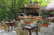 a jungle side open air restaurant on tulum beach road