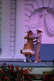 Folk dancing on stage in the main plaza