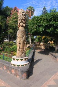 a stone sculpture at another corner of the plaza