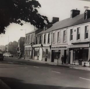 Old photo of TGosforth High Street showing T Punshon Newsagaent