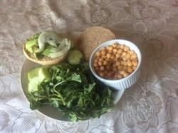 Homemade spelt bread with avocado, wartercress