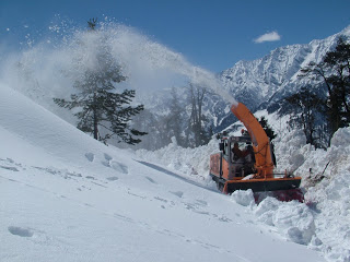 A snow cutter cuts through snow towards Rohtang