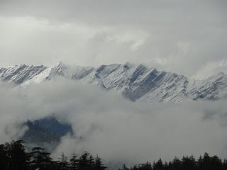 Snowfall on peaks near Manali