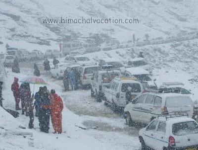 Tourists enjoy snowfall