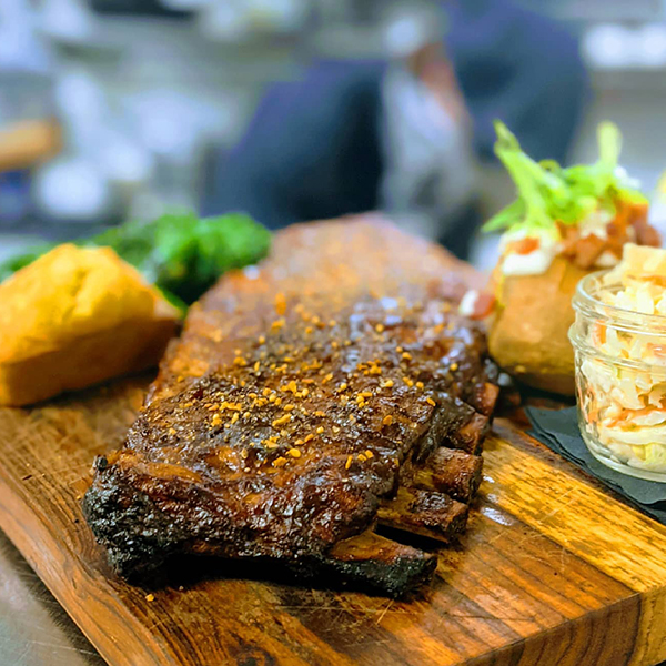 Barney's Butcher Block Special - St. Louis Ribs (Full Rack) served with Broccolini, Baked Potato, Homemade Corn Bread