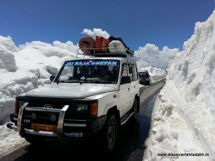 A vehicle plies Manali-Keylong highway at Rohtang pass