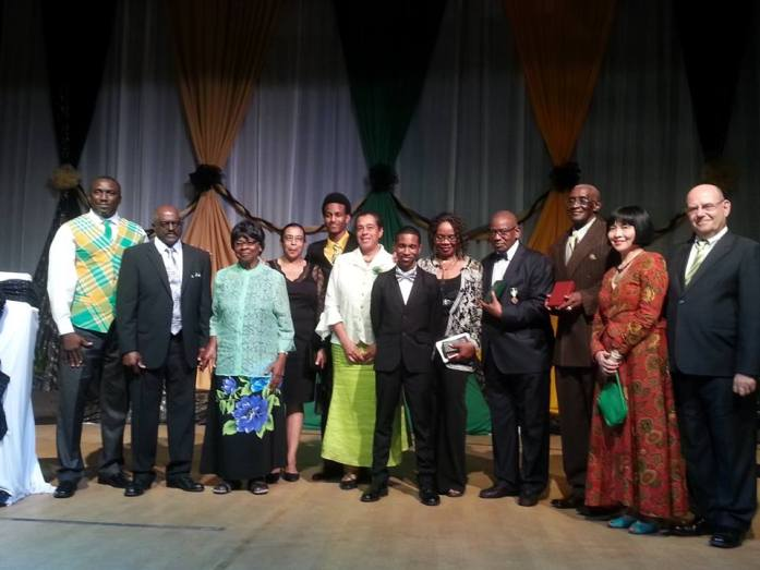 Awardees and their families along with Hon. Premier Donaldson Romeo (far left) and His Excellency the Governor and Mrs Davis (far right).