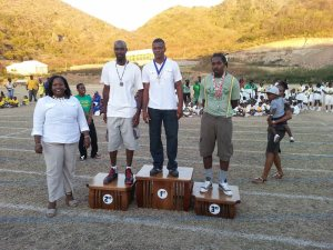 Hon. Minister of Education Mrs Delmaude Ryan and the winning dads.