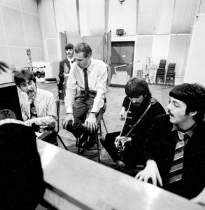 Photo of Sir George Martin and the Beatles in studio. (FB Page)