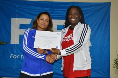 Discover Montserrat Editor Nerissa Golden receives her certificate for completing the FIFA Grassroots Coaching Course from Facilitator Andrea Rodebaugh-Huitron.